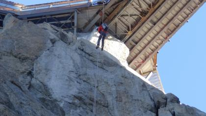 Tom Moores making the long, scary abseil from the Aiguille du Midi bridge.